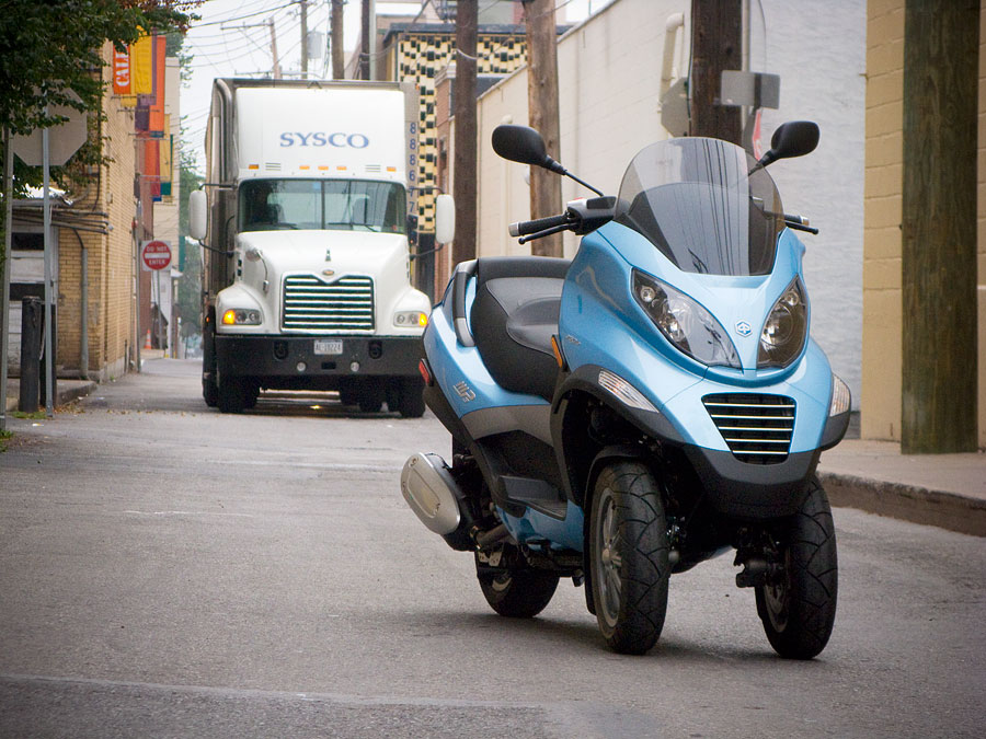 Piaggio MP3 250 scooter in an alley