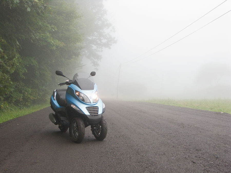Piaggio MP3 250 scooter on foggy road