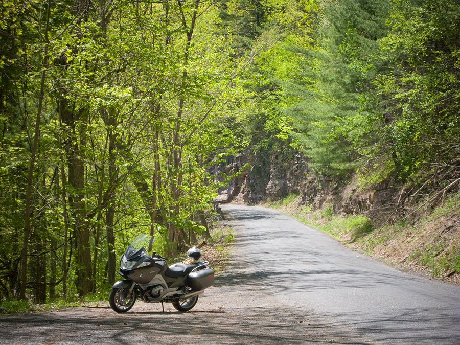 BMW R1200 RT motorcycle along a forest road