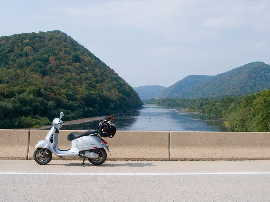 Vespa GTS scooter on bridge over Susquehanna River