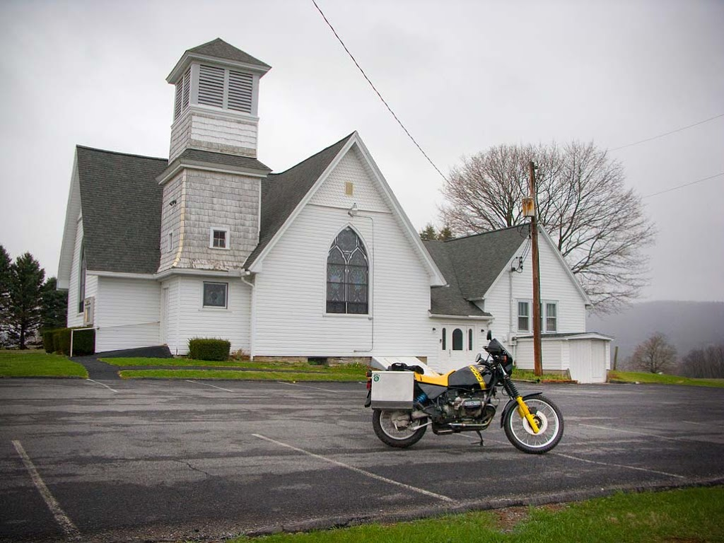 1988 BMW R100 GS bumblee motorcycle in church parking lot