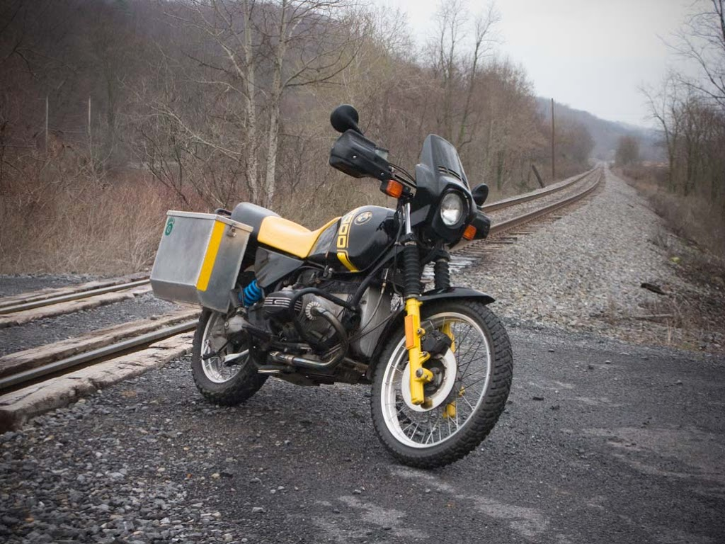 1988 BMW R100 GS bumblebee motorcycle on train tracks