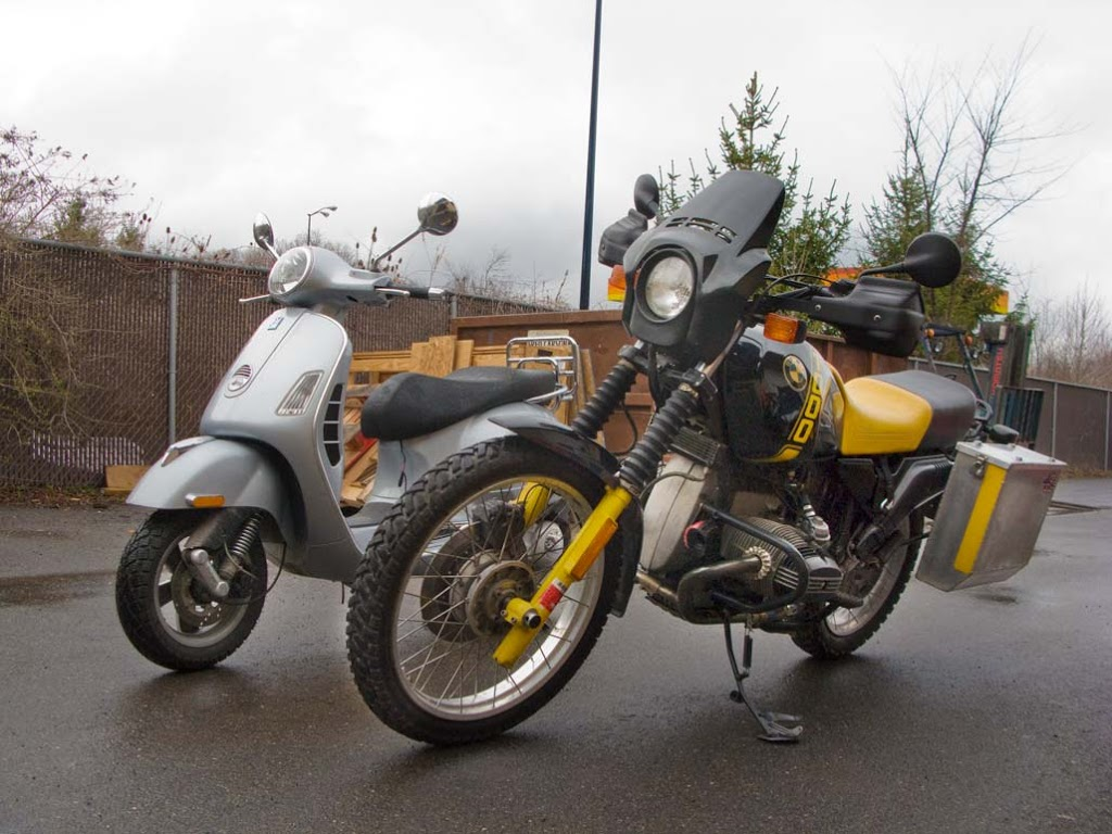 1988 BMW R100 GS motorcycle with a Vespa GTS scooter