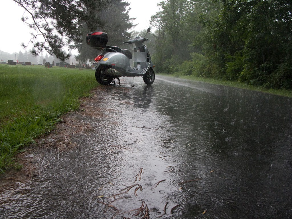 Vespa GTS scooter in rain