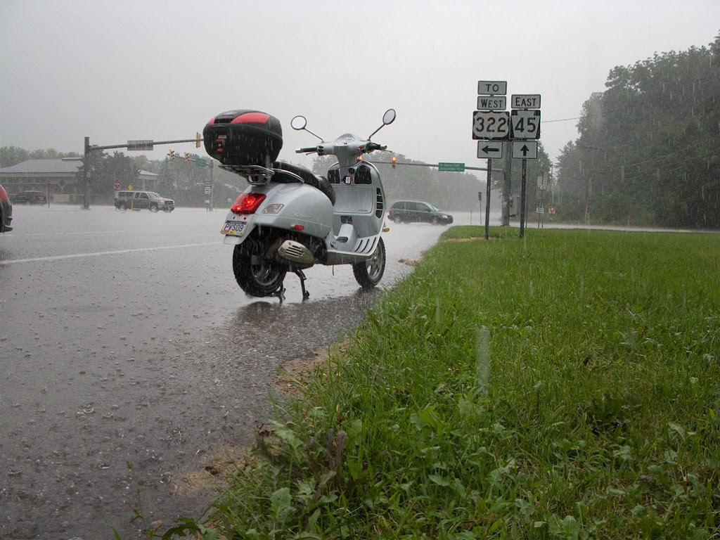 Vespa GTS scooter in heavy rain