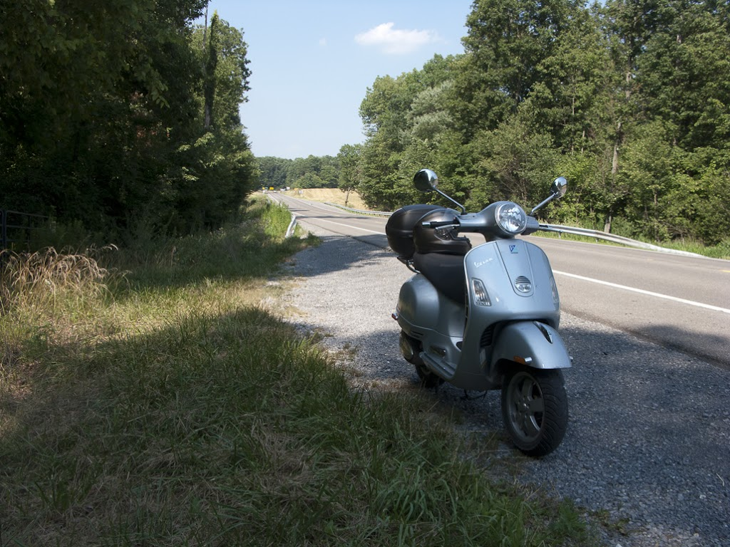 Vespa GTS scooter along country road