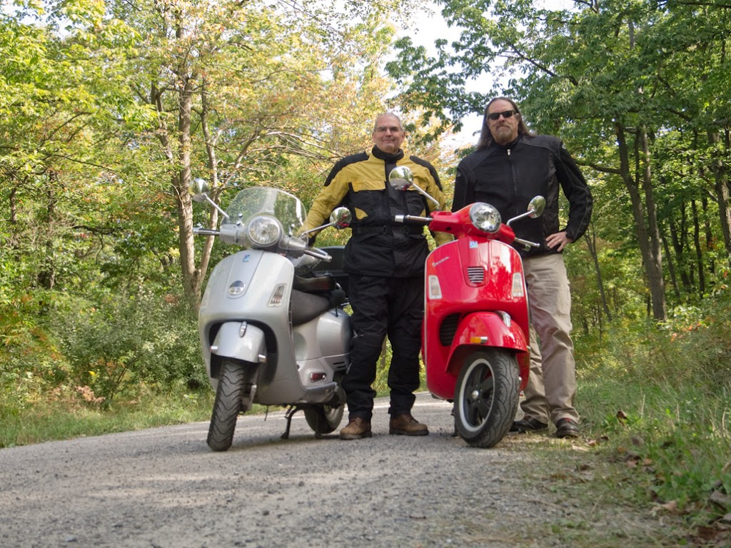 Steve Williams and Gordon Harkins with their Vespa scooters