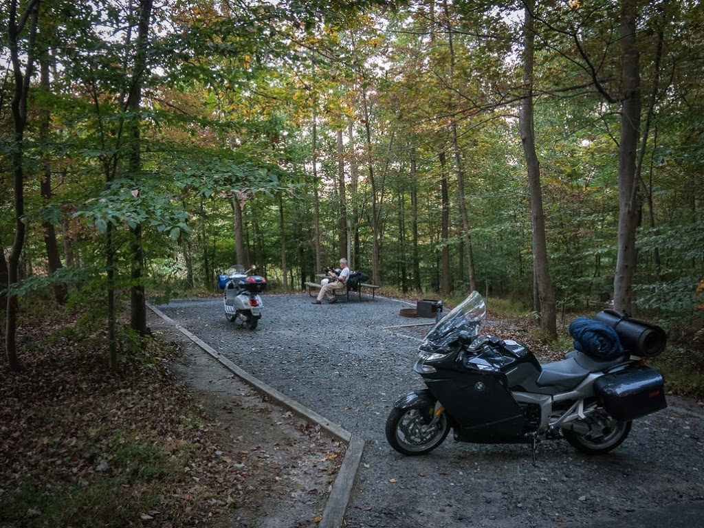 Camping with Vespa scooter and BMW motorcycle