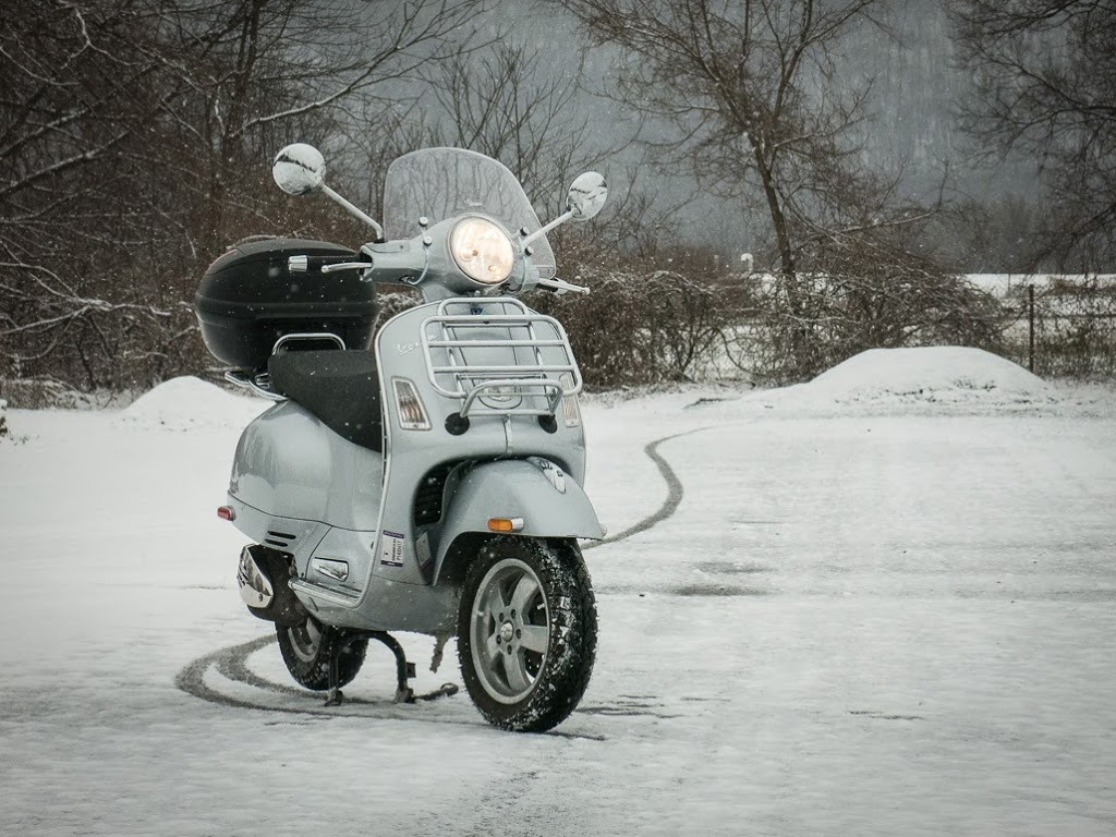 Vespa GTS on snow covered road