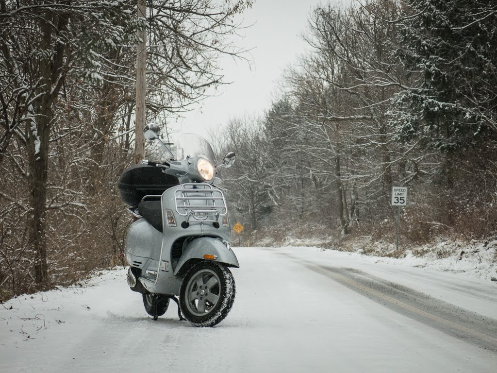 Vespa on snow covered road