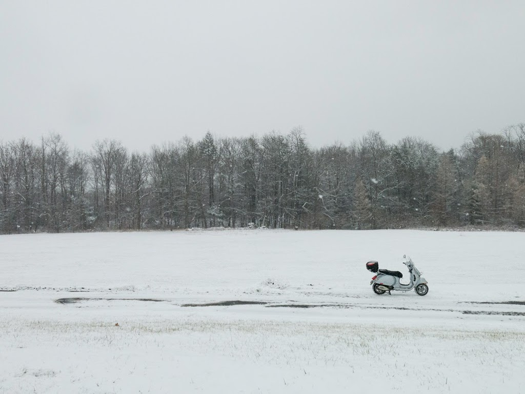 Vespa GTS scooter in snowy field