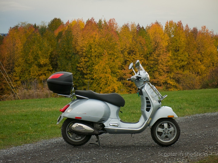 Vespa scooter and autumn leaves