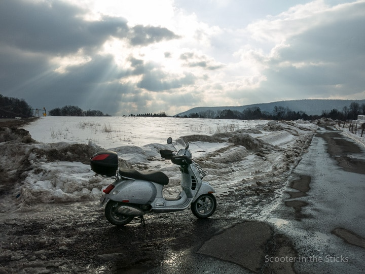 Vespa GTS scooter on an icy farm lane