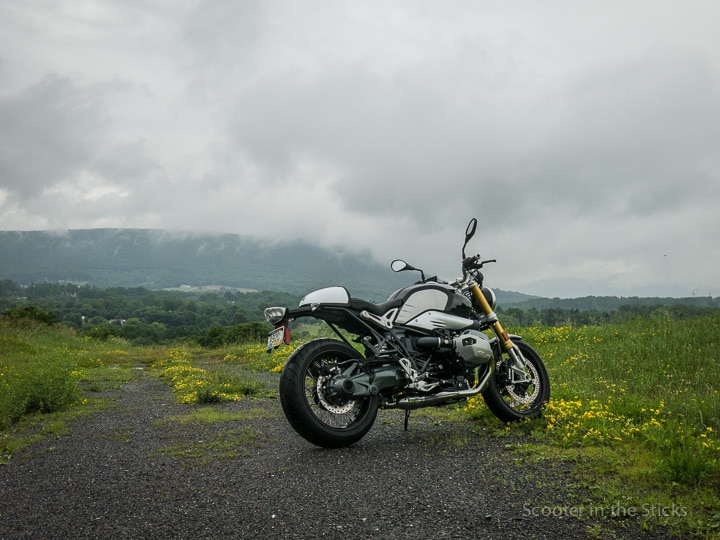 BMW R nineT motorcycle and Mt. Nittany in fog