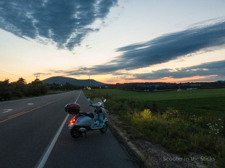 Vespa GTS scooter on the road before sunrise