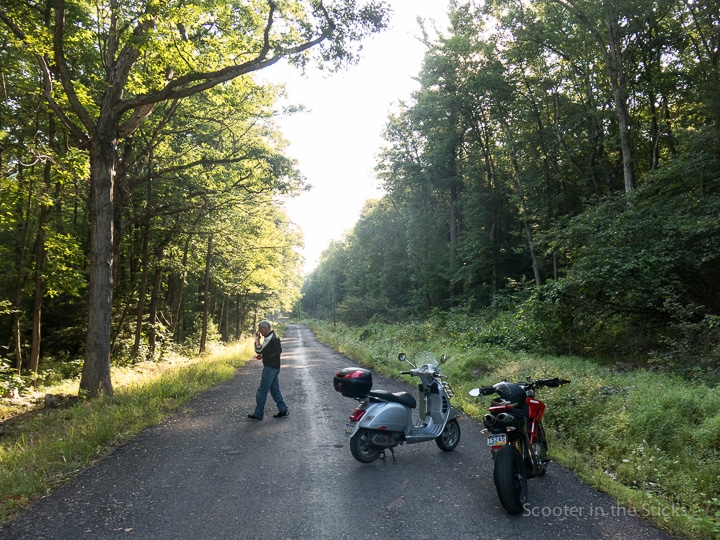 riding the vespa scooter and Ducati motorcycle on an abandoned road