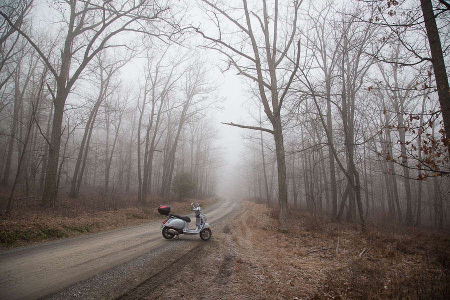 Vespa GTS scooter in the fog in Rothrock State Forest