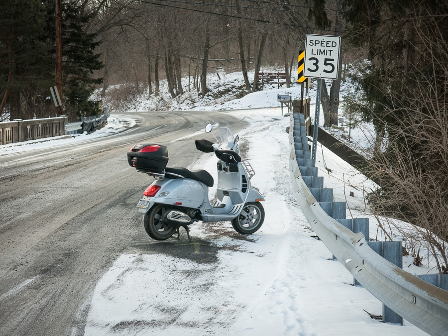 Vespa GTS scooter along winter road