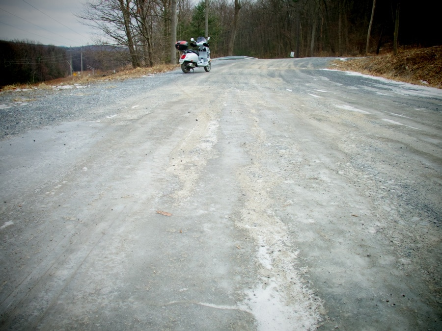 Vespa and ice covered road
