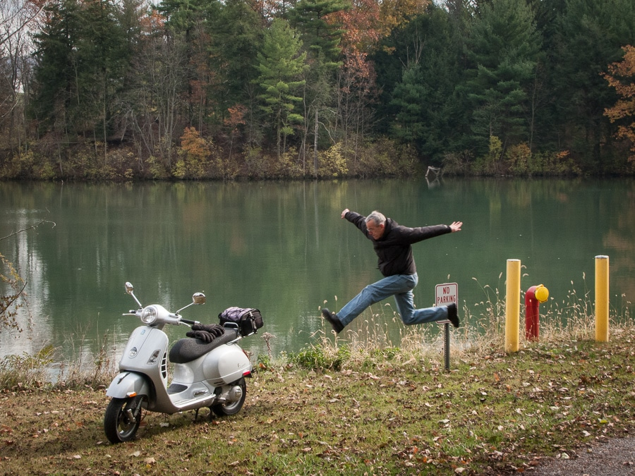 Paul Ruby leaping at the sight of a Vespa scooter
