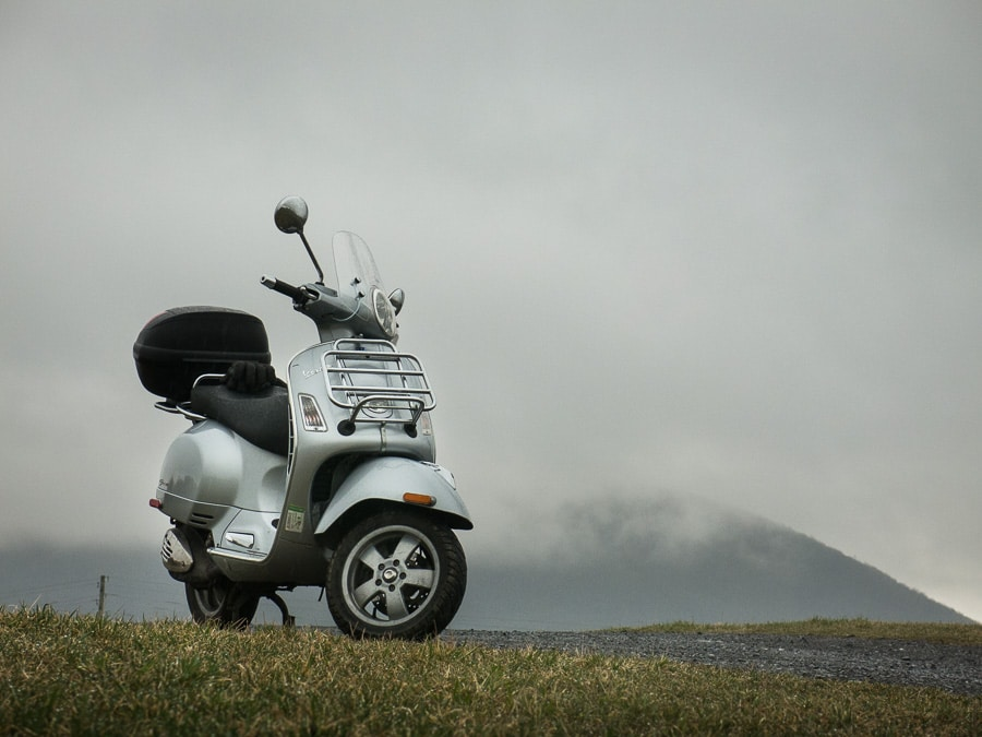 Vespa GTS scooter on rainy day