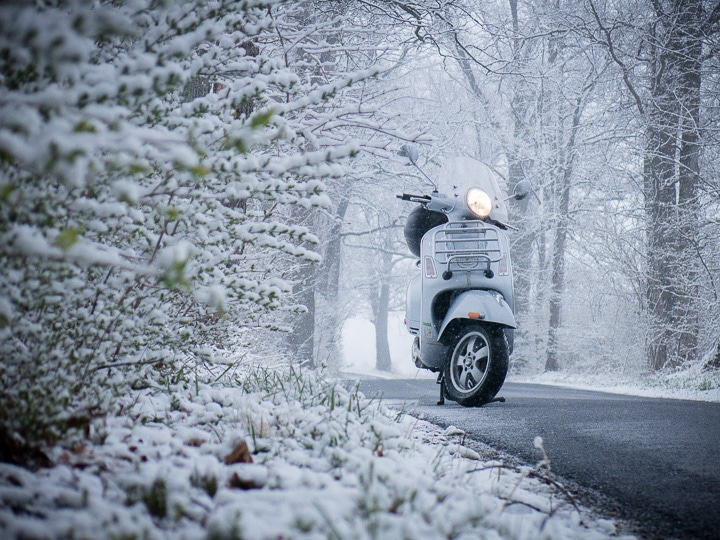 Vespa GTS scooter in a winter wonderland