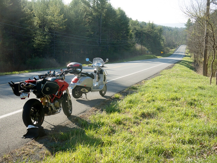 Ducati motorcycle and Vespa GTS scooter along route 45 in Pennsylvania