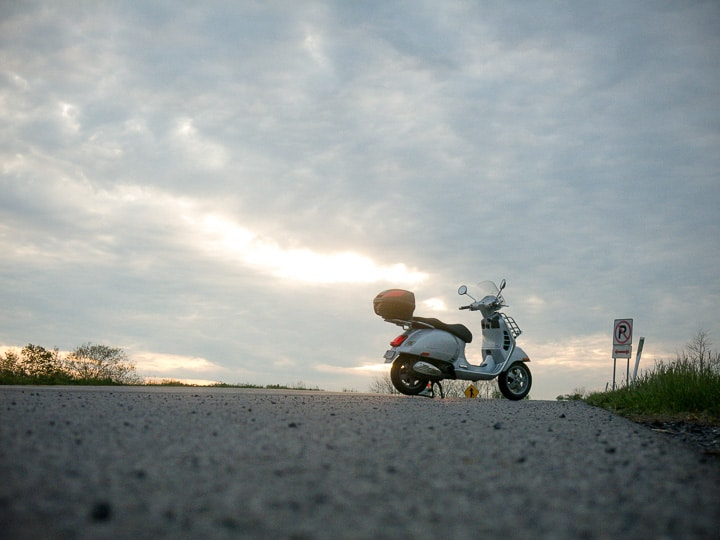 Vespa GTS scooter at sunset