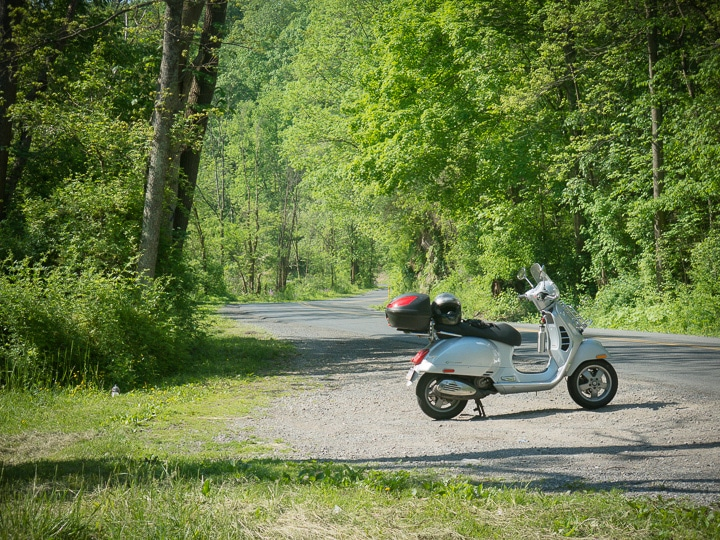Vespa GTS scooter along a country road