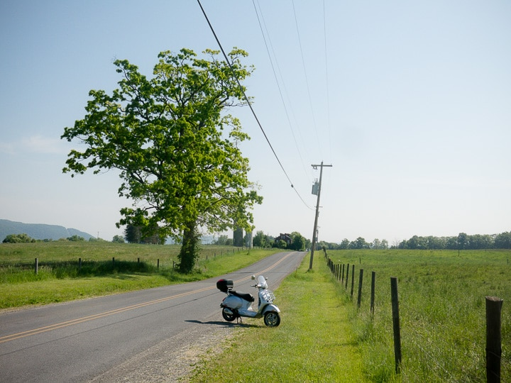 Vespa GTS scooter on rural road