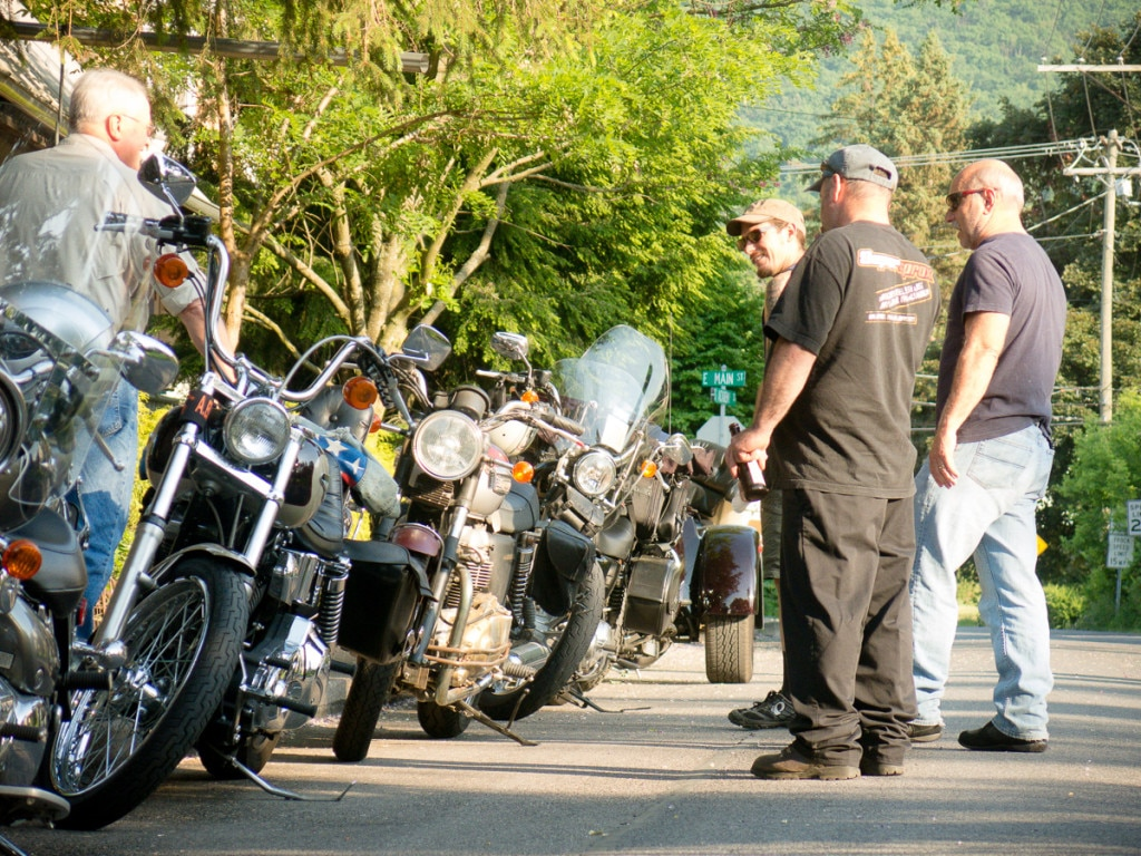 Motorcycles gathered along a street at the Boalsburg Moto Hang