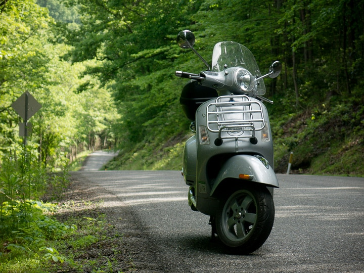 Vespa GTS scooter along road in Bald Eagle State Forest