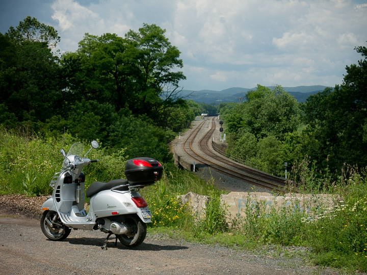 Vespa GTS scooter and railroad tracks