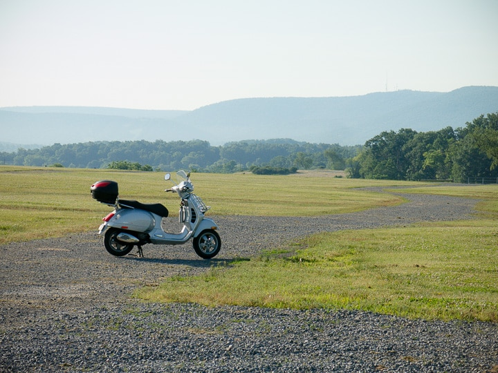 Vespa GTS scooter in open field