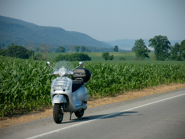 Vespa GTS scooter along rural road