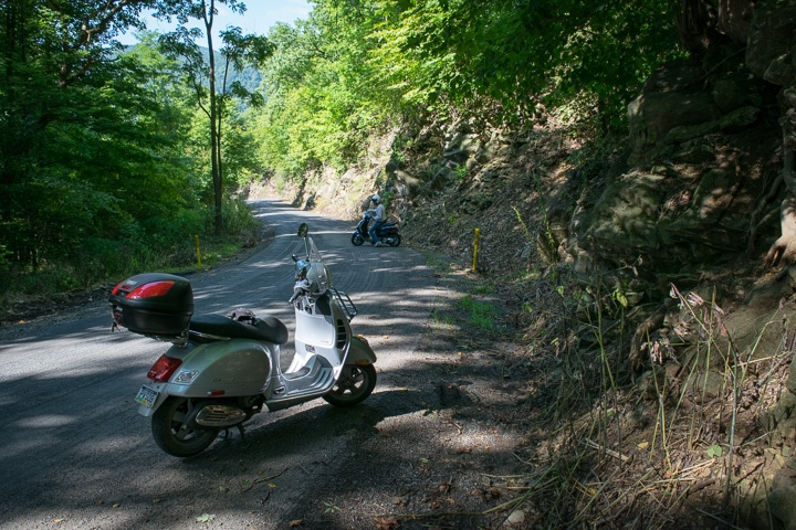 Vespa GTS scooter on winding road