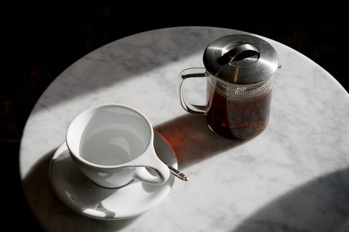 still life of an empty cup and a tea pot