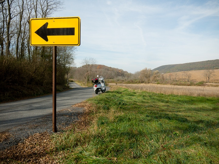 Vespa GTS scooter on rural road in central Pennsylvania