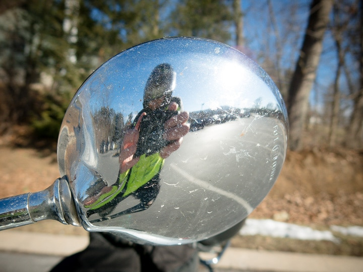 Reflection of rider in a Vespa GTS mirror