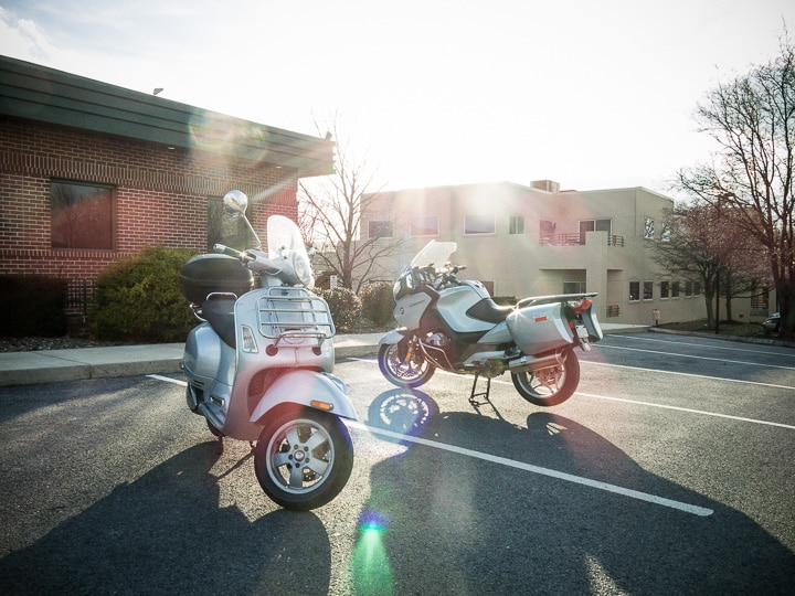 Vespa GTS scooter with BMW R1200 RT motorcycle