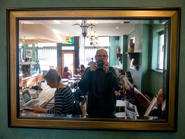 Reflection of Steve Williams in mirror at Saint's Cafe in State College, Pennsylvania