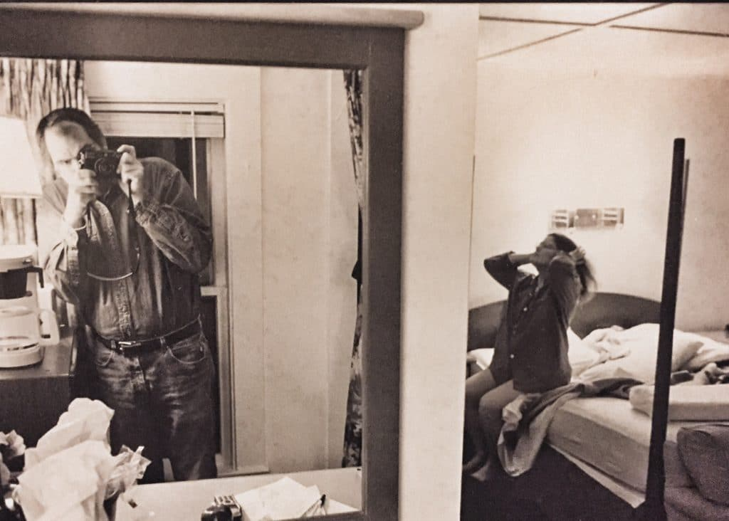 Husband photographing wife in a mirror
