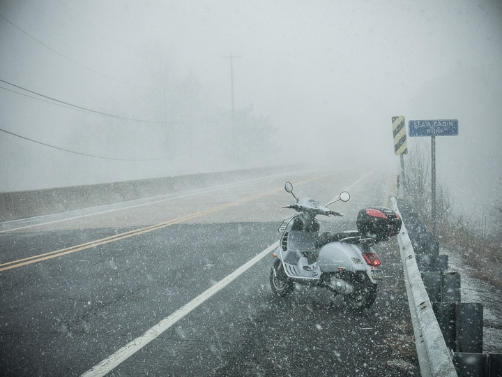 Vespa GTS scooter in a snow squall