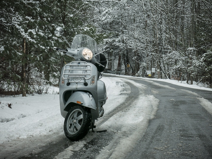 Vespa GTS scooter on a slush-cpvered winter road
