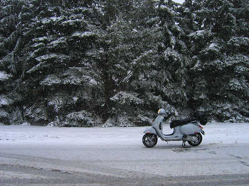 Vespa GTS scooter on snowy road