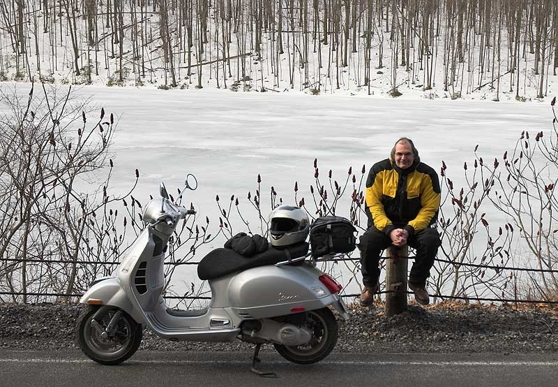 Steve Williams with his Vespa GTS scooter in winter
