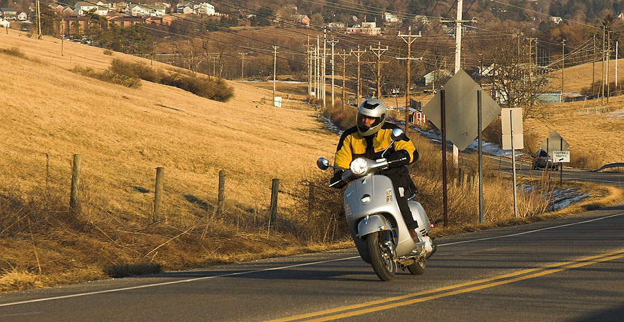 Steve Williams riding his Vespa GTS 250