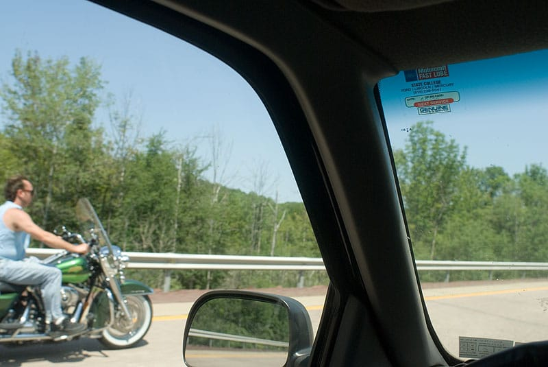 Harley and helmet-less rider on Interstate 80