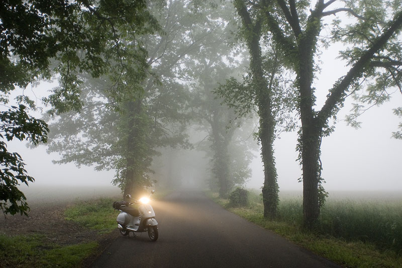 Vespa GTS scooter in the fog