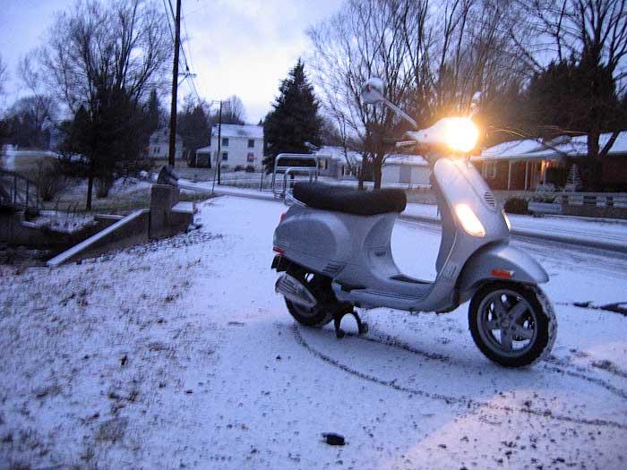 Vespa LX150 on a snowy road